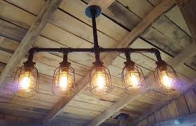 industrial cage work light chandelier a custom made rustic industrial chandelier black pipe with interior design ideas home decorating inspiration