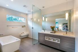 bathroom with walk in showers without door with white emboss wall in one side glass