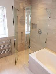 a bespoke overbath shower enclosure with frameless door and wet room flooring by room h2o