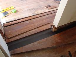 Wet Kitchen Floor Flooded Kitchen Wet Water Damaged Wood Flooring Albuquerque