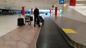 Airport Worker Collects Lost Luggage From The Conveyor Stock Video
