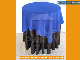 black tablecloth on cocktail table with royal blue overlay tablecloth linen als