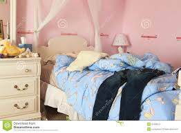 unmade messy bedroom of age stock images