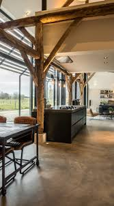 Converting an old farm into a warm industrial farmhouse with big view on an  old brick wall, original wooden beams and the beautiful area around the ...