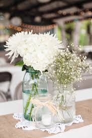 Rustic/vintage wedding centerpiece with mason jars, baby's breath, mums,  and hydrangeas