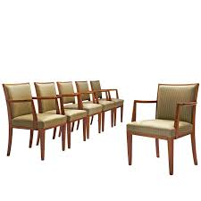 large set of 11 danish armchairs in teak and original black upholstery at 1stdibs