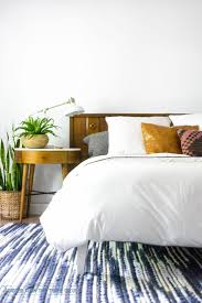 Modern Eclectic Mid-Century Bedroom with white duvet (Crane & Canopy), West