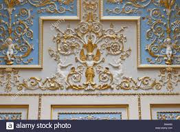 Gilded Design Wall With Gilded Carvings On White And Blue Panels Showing