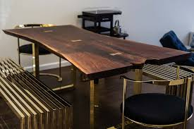 black walnut dining table with brass bowties