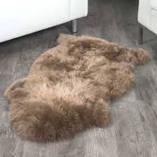 sheepskin rug ft brown extra large rugs c larger photo email a friend brown sheepskin rug natural