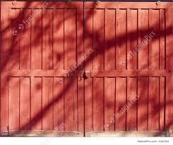 red barn door. Rustic Red Backgrounds: Barn Door With Oak Shadow Falling Across, Background \