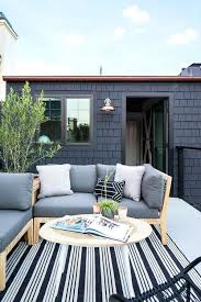 small patio rugs small patio space with gray sofa and striped outdoor rug furniture near