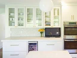 modern white glass slab door cabinets with gold hardware