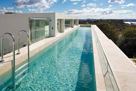 Image Design Lover While Most Homeowners Lean Towards Inground Swimming Pools This Design Goes To Show That With Little Creative Thinking You Can Create Something Truly Completehome Luxurious Lap Pool Designs Completehome