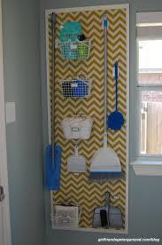 pegboard broom closet system 20 laundry room organization ideas