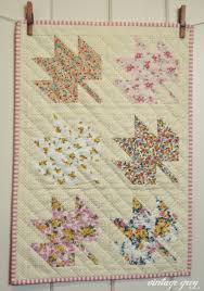 vintage grey: mini maple leaf quilt & I kept the hand quilting simple with just one set of diagonal lines, which  I loved how it turned out! Adamdwight.com