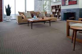 carpet flooring in living room couch and table fireplace