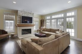 Family Room With Stone Wall Fireplace And Hardwood Floors