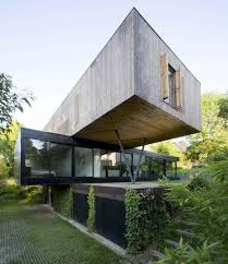 View in gallery cantilevered-french-house-design-in-wood-and-glass-