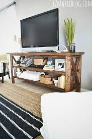 All the dimensions obviously can be altered to fit any area of your house.  To get the starting dimensions, I took our previous TV stand, ...