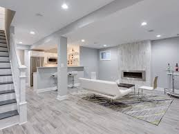 Contemporary Basement With Kingsman Zero Clearance Direct Vent Linear Gas  Fireplace, Hardwood Floors, Carpet, Columns