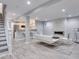 Contemporary Basement With Kingsman Zero Clearance Direct Vent Linear Gas  Fireplace, Hardwood Floors, Carpet, Columns