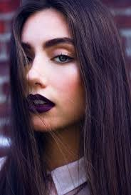 gothic makeup look with purple lipstick