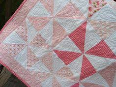 Wee Ones baby quilt by Kelly Guy. Kelly of Charming Chatter is a ... & Pinwheel Baby Quilt by emptybobbin Adamdwight.com