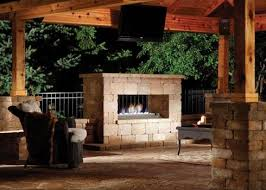 nothing does a better job of transforming a backyard patio into an outdoor room than a fireplace a double sided design allows you to enjoy the heat and