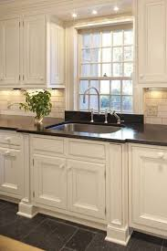 black granite countertop and best grey ceramic floor for classic interior ideas with small recessed lights finding the best lighting over kitchen