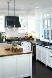 white cabinets dark counters light cabinets dark counter oak floors neutral tile black splash white white