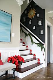 dark wall on staircase with photos