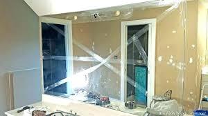 wall removing mirror glued on sheetrock wa how