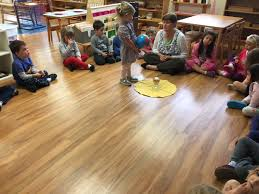 preschool students gather in a cirle to share with eachother