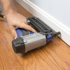 attaching baseboard to the wall