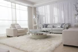 bedroom white plush area rug dusty wallpaint caramel brown simple sofa beige furry plain cupboards