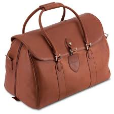 the pineider country leather travel bag is beautifully crafted for luxury travel with its large capacity and shoulder strap available in 5 colors