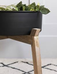 black iron wood plant stand