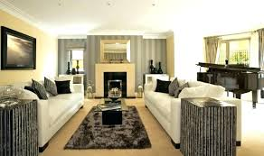 decorating living room with fireplace decorating a rectangular living room fireplace in middle of room how decorating living room with fireplace