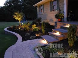 frontyard hardscape with entryway steps landscape retaining wall paver walkway illuminated with led lights