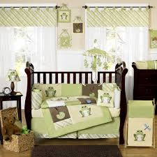 attractive nursery themes for boys with rug and wooden crib