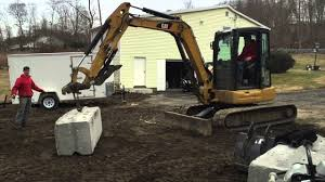 Ultimate Mini Excavator Challenge Kubota U55 Vs Cat 305 Strength Test