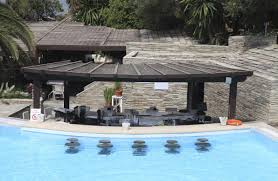 swimming pool: Resort Pool Bar - Amazing Pool with Bar for Cozier  Entertainment Features,