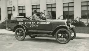 henry ford model t 1920s. henry and edsel driving the 15 millionth model t courtesy ford museum 1920s