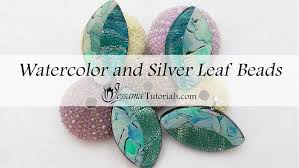watercolor and silver leaf polymer clay pendant