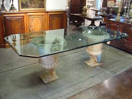beveled glass table top on antique french stone urns le
