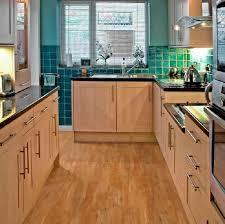 vinyl wood flooring kitchen kitchen with black countertops and vinyl plank flooring