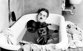 charlie chaplin portrait of the moralist essay by robert payne  charlie chaplin sleeps in a bathtub in a scene from his 1922 film pay day