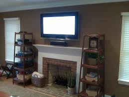 tv above fireplace where to put cable box and demonstrate how to use your components