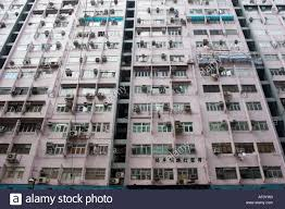 air conditioning units for apartments. busy apartment building in wan chai area of hong kong. exteriors are covered air conditioning units. units for apartments